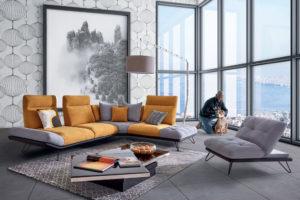 Décoration du canapé d'angle Buzz HomeSalons avec un tableau et un papier peint